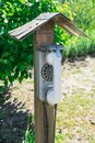 Old street disk wired phone. The village telephone booth. Royalty Free Stock Photo