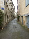 Old street in france peaceful french with coloured shutters and plaster walls Stock Photos