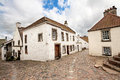 Old street and historical houses, Curloss Stock Photo