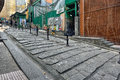 Old street in hong kong pottinger is an central also known as the stone slabs because of the granite stone steps Royalty Free Stock Images