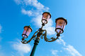 Old street lamp on blue sky Royalty Free Stock Photography