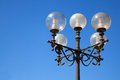 Old street lamp on blue sky Royalty Free Stock Image