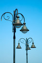 Old street lamp on blue sky Stock Photos