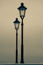 Old street lamp at dusk Stock Photography