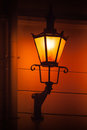 Old street lamp light tallinn estonia on the wall at night Royalty Free Stock Photo