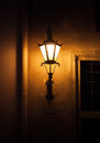 Old street lamp light in tallinn estonia on the wall at night town of Stock Photography