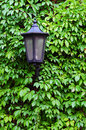 Old street lamp on a wall Royalty Free Stock Photo