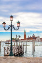 Old street lantern in venice italy with the isle of san giorgio maggiore the background Stock Image