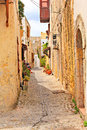 Old street in rhodes town narrow the medieval of greece Royalty Free Stock Photos