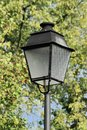 Old streetlamp close up on an and tree background Stock Photo