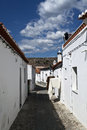 Old streets of serpa portugal the town contained within the castle walls is a nostalgic place narrow cobbled lined with red sloped Royalty Free Stock Photos
