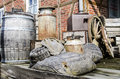 Old stuff from barn vintage nostalgia farm metal barrel wooden boxes fruit cases grain bags and other Stock Photo