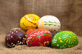 Old style easter eggs on decorative rustic background Royalty Free Stock Images