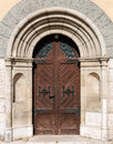 Old style front wooden door in arch Royalty Free Stock Photo