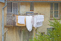 Old style laundry hanging from an upper story clothesline on an building in ventimiglia italy Stock Photos