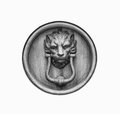 Old style lion`s head knocker isolated.