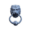 Old style lion`s head knocker isolated on white.