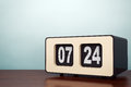 Old style photo vintage flip clock on the table Royalty Free Stock Photography