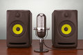 Old Style Photo. Vintage silver microphone and Audio Speakers Royalty Free Stock Photo