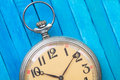 Old style pocket watch on blue wooden backround close up of Royalty Free Stock Photos