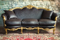 Old style sofa luxury against stone wall Stock Image