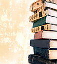 Old style stack of books on grunge background Royalty Free Stock Images