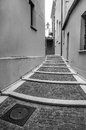 Old style street with stairs black and white picture of historic staircase in sardinia Royalty Free Stock Photos