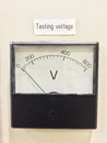Old style voltmeter gauge. Voltage meter of test room. Royalty Free Stock Photo