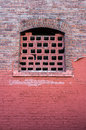 Old style window on red bricks wall Royalty Free Stock Photo