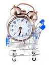 Old-styled alarm clock in small shopping cart. Stock Images