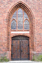 Old stylish door in Polish cathedlak Royalty Free Stock Photo
