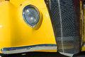 Old stylish yellow collectible ancient car Stock Images