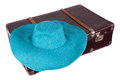 Old suitcase with blue hat Royalty Free Stock Photo
