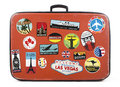 Old suitcase with stickers worn travel from around the world Stock Photo