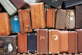 Old suitcases in a big pile seen from the side Royalty Free Stock Photography