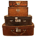 Old suitcases and boxes stacked isolated on white background Royalty Free Stock Photos
