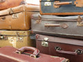 Old suitcases stacked on a bench of an antiquary Stock Photo