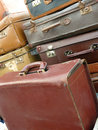 Old suitcases stacked on a bench of an antiquary Royalty Free Stock Photography