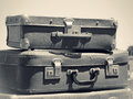 Old suitcases vintage travel bags on the road monochromatic toned color in retro style voyage on an automobile classic baggage Royalty Free Stock Images