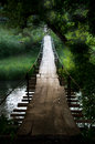 Old suspension bridge in an old maountain village Royalty Free Stock Photo