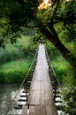 Old suspension bridge in an old mountain village Royalty Free Stock Photo