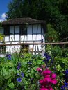 Old swiss farm house with flowers in garden in open-air museum ballenberg in switzerland Royalty Free Stock Photo