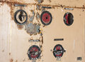 Old swithces closeup of an machine switches in metal plate with peeling paint Stock Photo