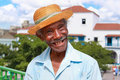 Old sympathetic cuban man with straw hat make a fu Royalty Free Stock Photo