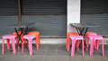 Old tables and plastic chairs at thai footpath restaurant Royalty Free Stock Photos