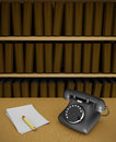 Old telephone on desktop Stock Photos