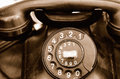 Old telephone rotary close up sepia with grain added Royalty Free Stock Photos