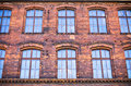 Old tenement house wall made by brick Stock Photography