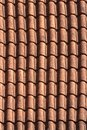 Old terracotta tile roof close up. background vertical Royalty Free Stock Photo