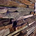 Old textured brick wall of stylish stones for home decor